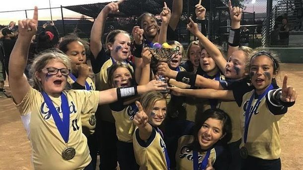 Foothills Gold - Williams 10U celebrate after a championship win